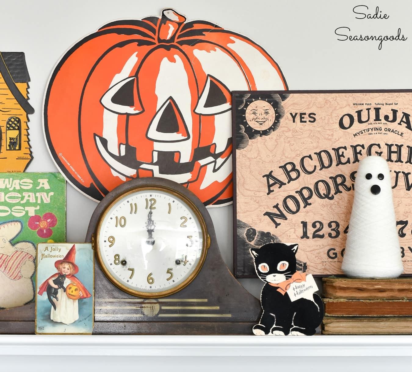 Vintage Ouija board as Halloween mantel decor