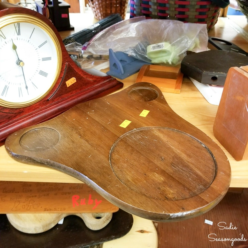 Wooden cheese board at a thrift store