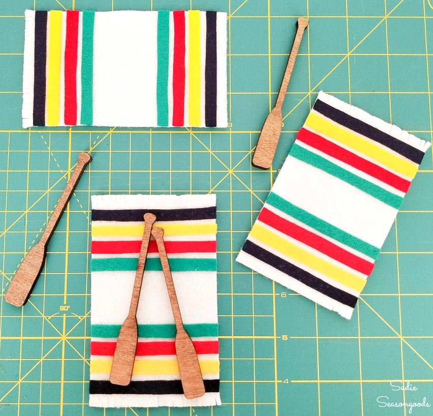 Cabin Christmas ornaments inspired by Hudson Bay