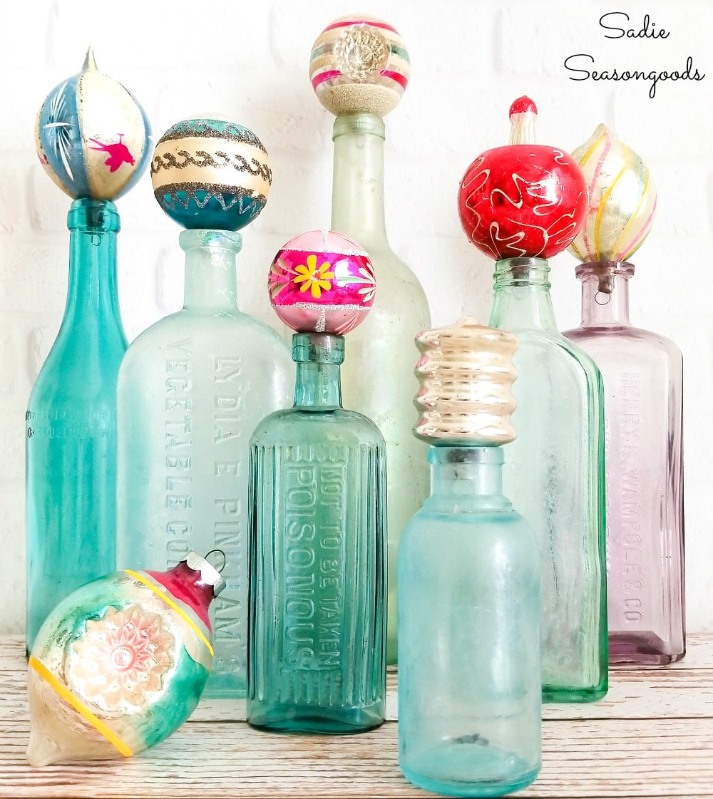 Thrifty Christmas decor with vintage ornaments as bottle toppers