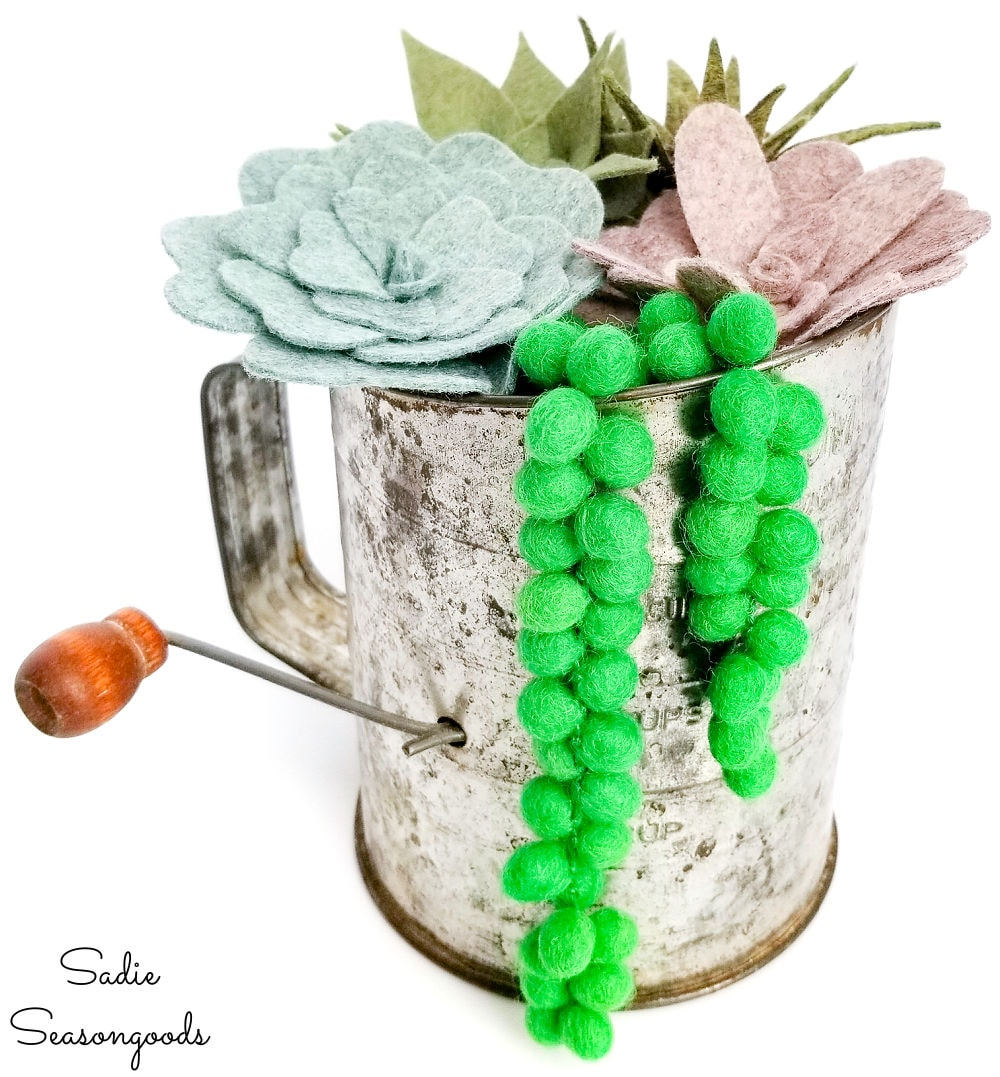 Felt succulents in a vintage sifter