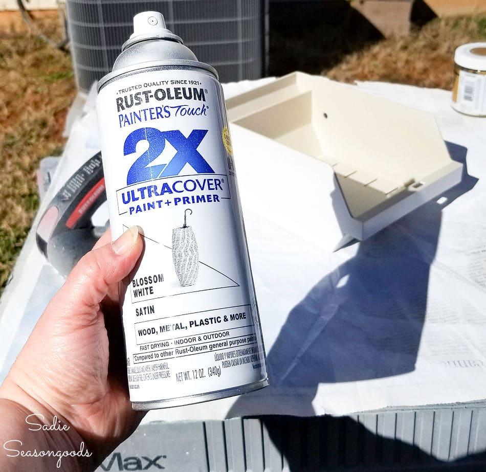 spray painting a floppy disk holder