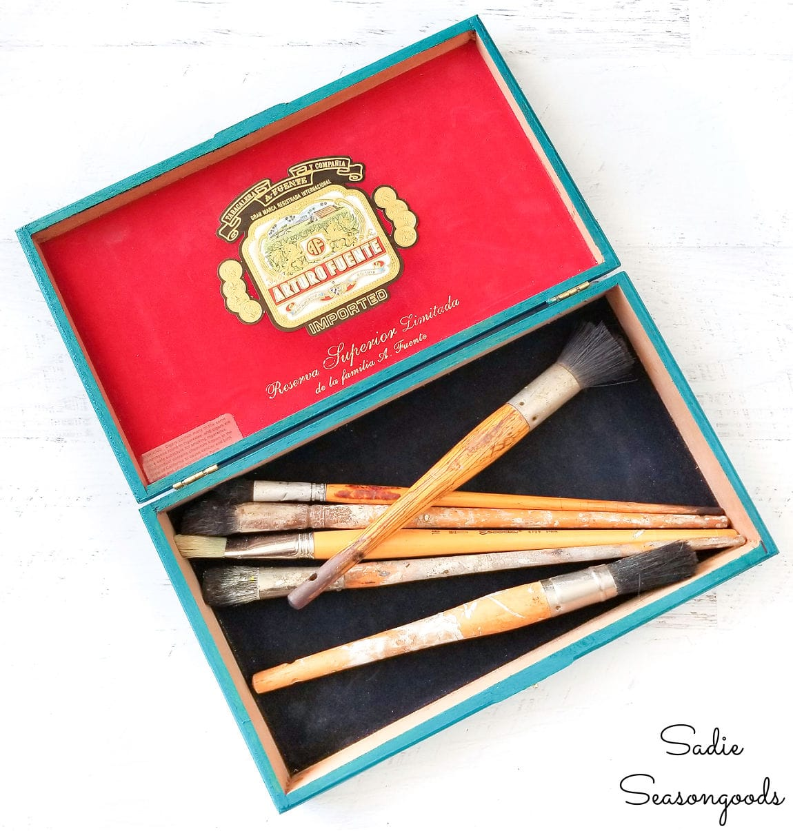 old paint brushes in a cigar box