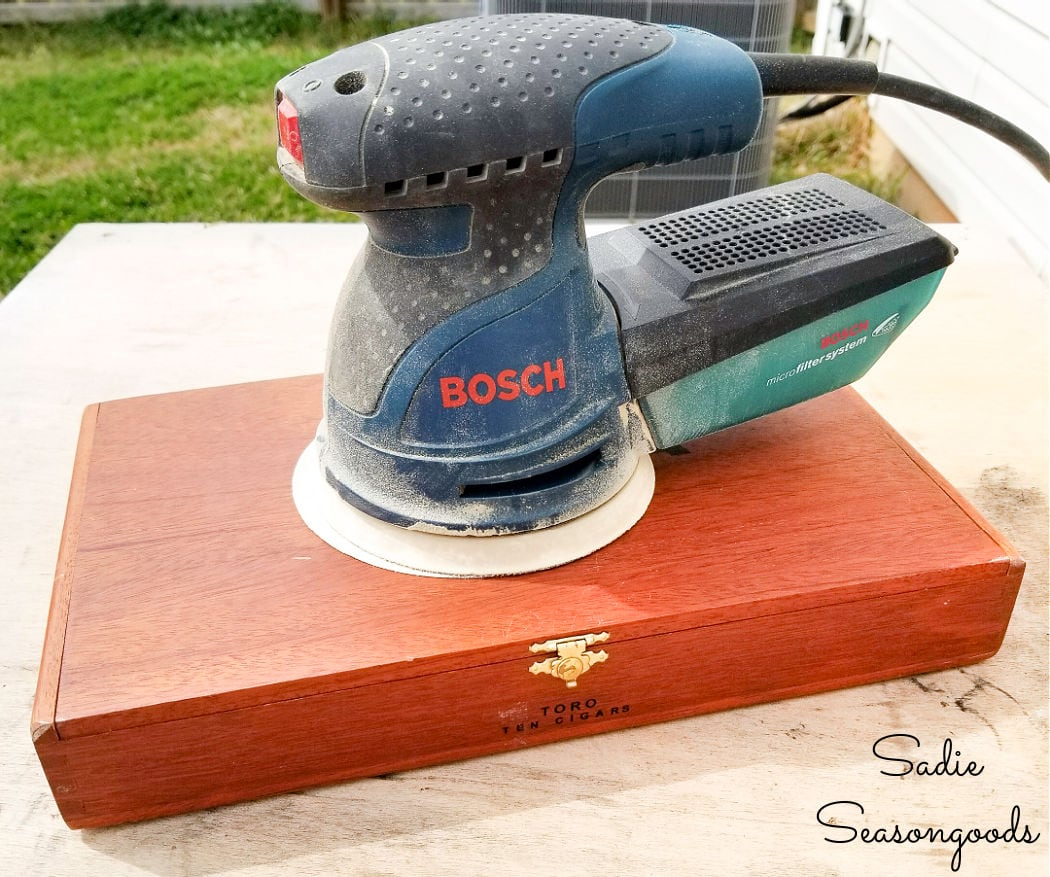 sanding the wooden cigar boxes