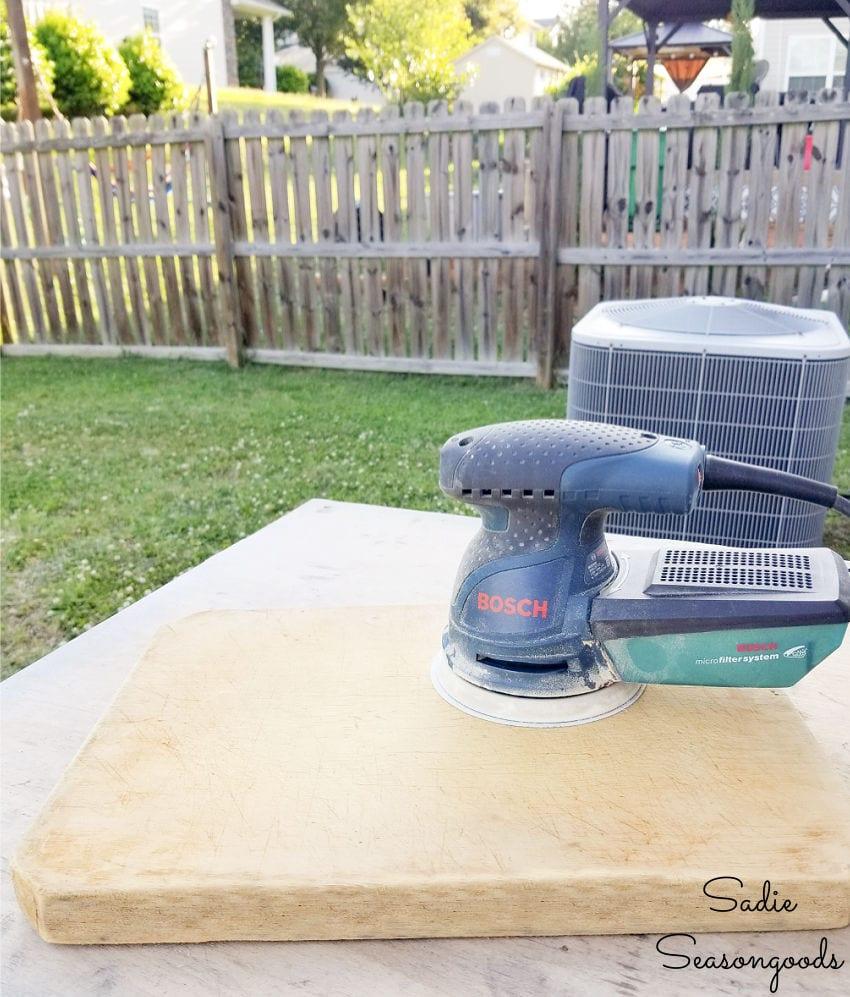 sanding an old cutting board