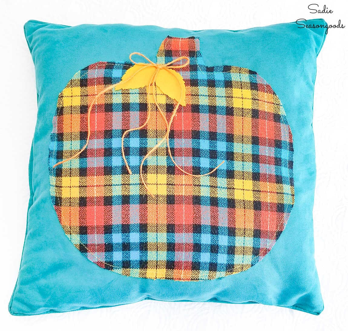 pumpkin throw pillow from an upcycled flannel shirt